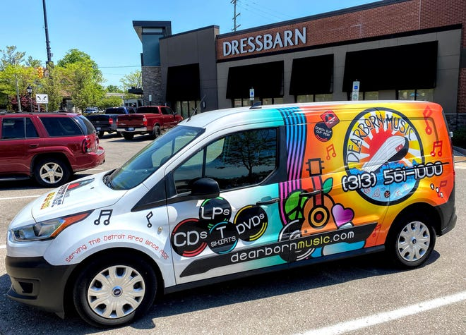 A Dearborn Music vehicle parked outside the former Dressbarn location in downtown Farmington. The shop is planning to open a location inside the former clothing shop along Grand River Avenue.