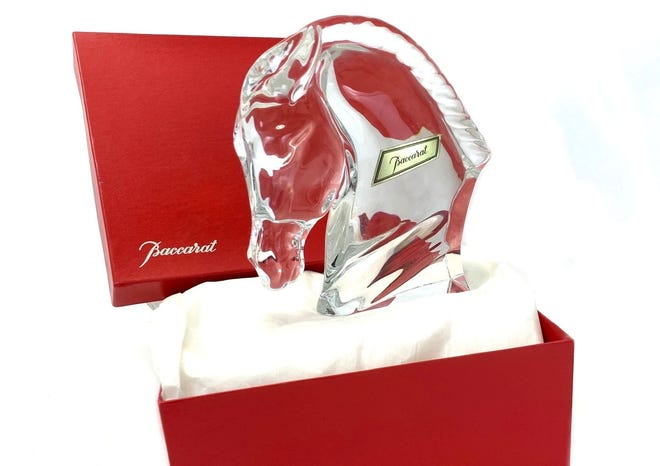 Sleek figural horses like this are a Baccarat specialty.
