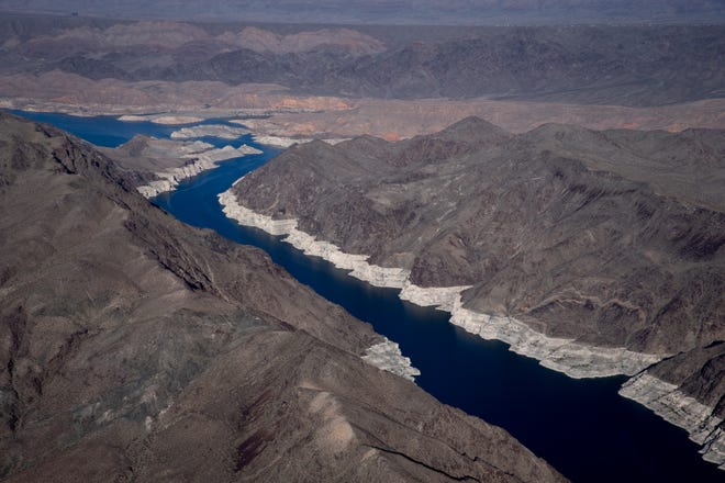 Virgin Canyon (right) leads into Gregg Basin (top left), May 11, 2021, in the Lake Mead National Recreation Area, on the Arizona/Nevada border. A high-water mark or bathtub ring is visible on the shoreline; Lake Mead is down 152 vertical feet.