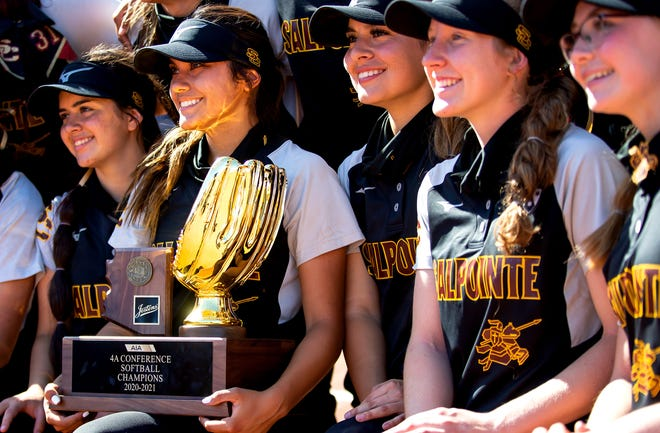 Salpointe's Alyssa Aguilar, 44, holds the trophy while posing for a group photo with her teammates after Salpointe Catholic's 5-4 win over Vista Grande in AIA's 4A State Softball Championship at Rita Hillenbrand Memorial Stadium,1700 E. 2nd St., in Tucson, May 14, 2021. The Salpointe Catholic Lancers are the 4A State Champions.