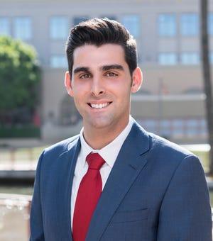 Phoenix insurance executive Elijah Norton is considering a run for Congress as a Republican challenge to Rep. David Schweikert, R-Ariz.