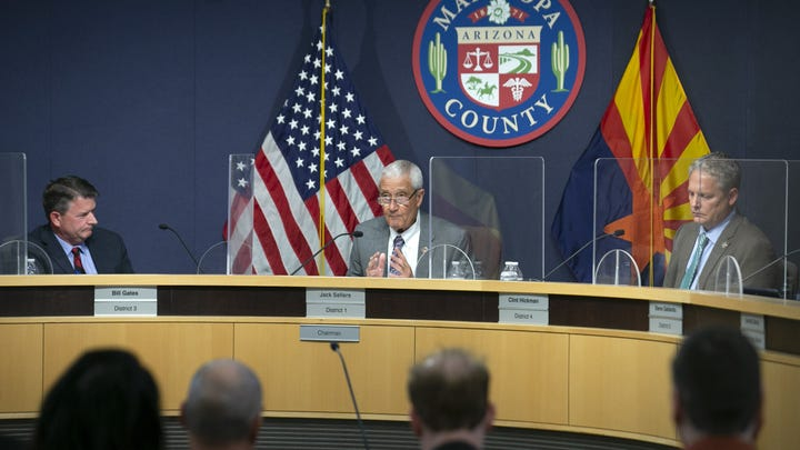 Vice-chairman Bill Gates (from left), Chairman Jack Sellers and Supervisor Clint Hickman attend a Maricopa County Board of Supervisors meeting about the Senate audit of Maricopa County ballots from the 2020 general election in Phoenix on May 17, 2021.