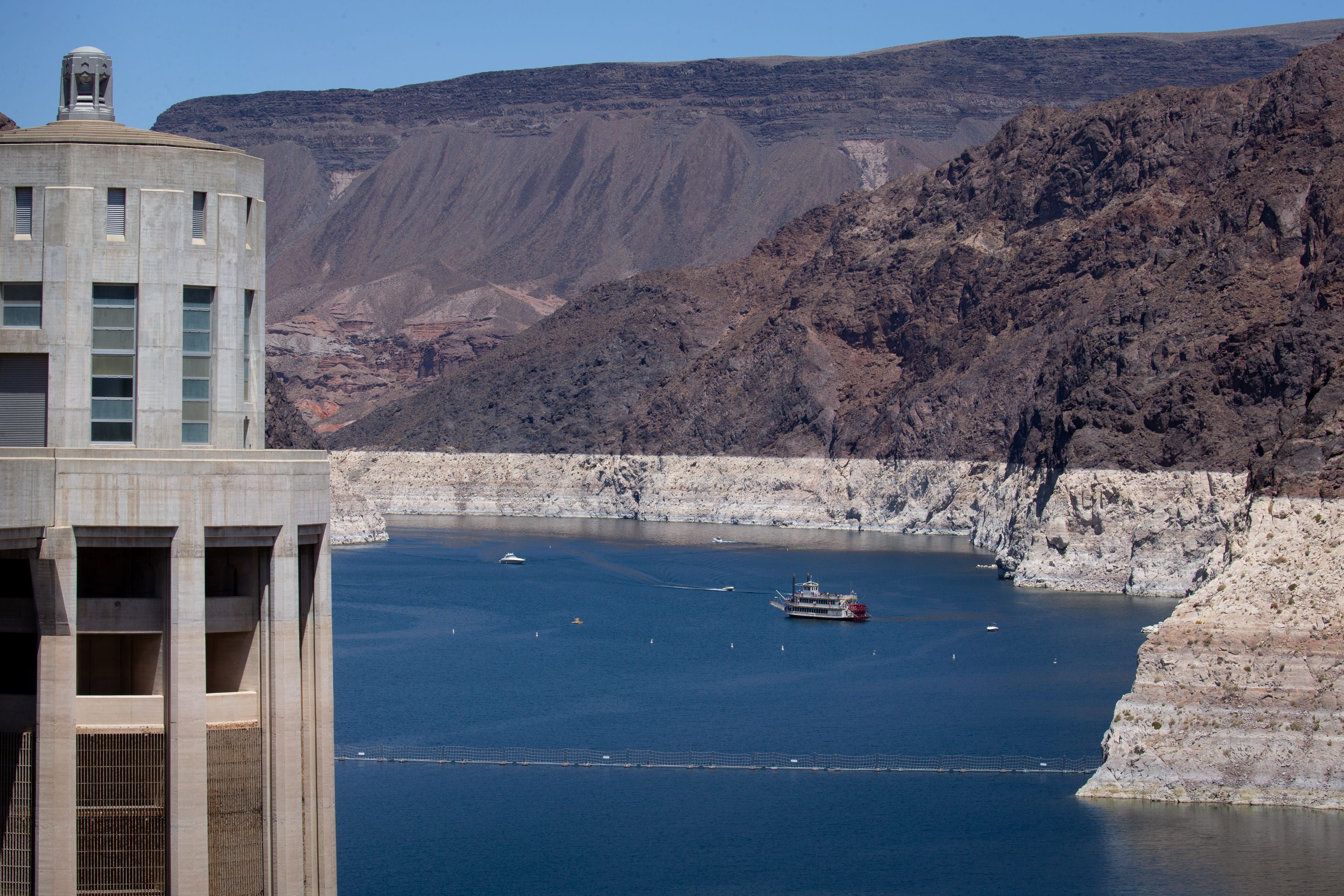 An intake tower (left) stands in Lake Mead beside Hoover Dam, which straddles the Arizona-Nevada state line on the Colorado River.