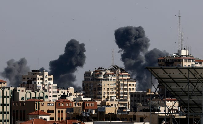 Smoke billows from Israeli airstrikes in the Gaza Strip, controlled by the Palestinian Islamist movement Hamas, on May 11, 2021. (MMahmud Hams/AFP/Getty Images/TNS)