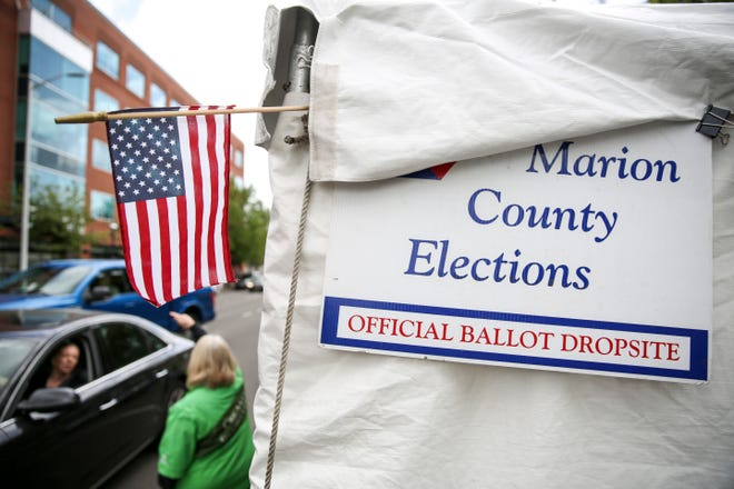 Voters drop off their ballots on election day at a drive-thru location outside the Marion County Courthouse on Tuesday.