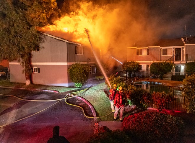 Visalia Firefighters battle an apartment blaze in the 3900 block of South Shady Street on Monday, May 17, 2021. Occupants of four apartments were displaced by the fire damage.
