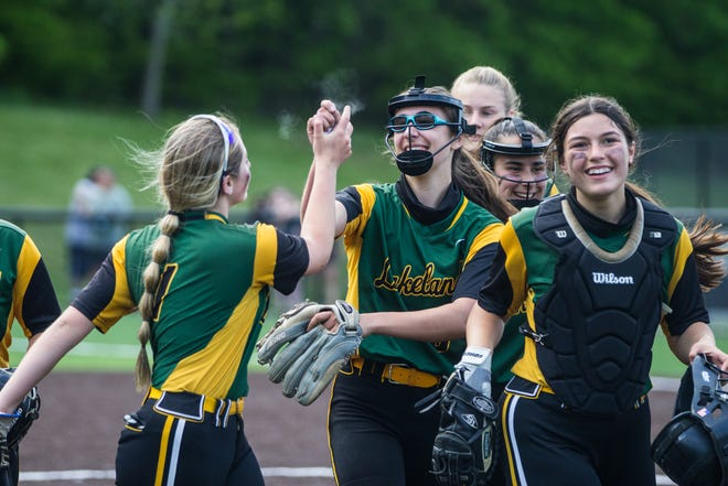 Stella Bale (center) celebrates with her Lakeland teammates after defeating Yorktown, 3-0, on Monday, May 17, 2021.