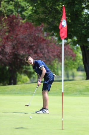 Suffern's Sead Stead hits his putt on the 18th green during the Rockland County Boys Golf Championship at Phillip J. Rotella Memorial Golf Course in Thiells on Tuesday, May 18, 2021.