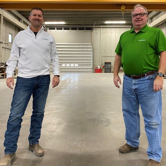 True North Equipment CEO John C. Oncken, left, and chairman Dan Gorder, right, have developed a specialized facility in which to build and repair farm equipment in Grand Forks, N.D.