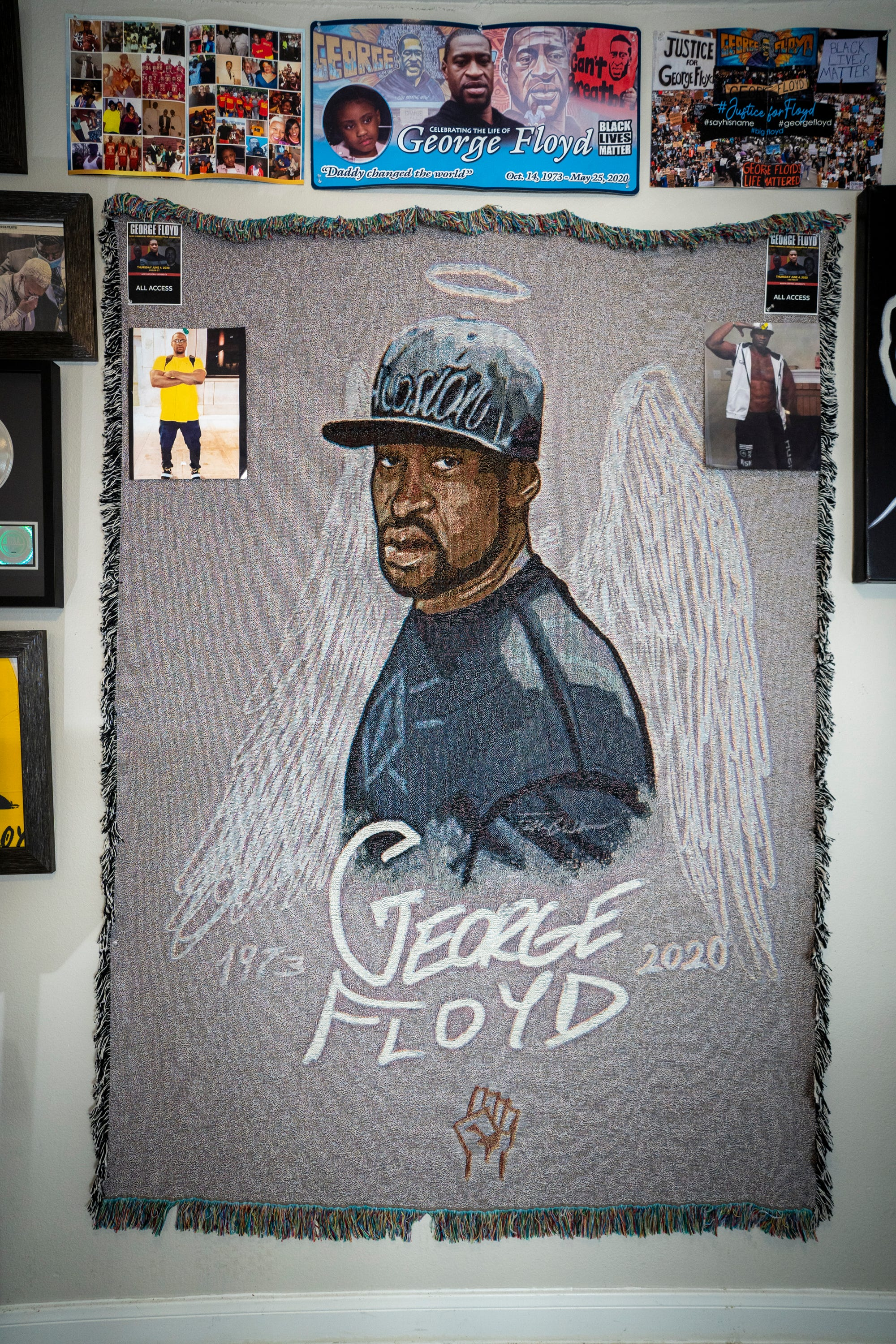 LaTonya Floyd sleeps under a hanging tapestry of her brother George Floyd just like this one that adorns the wall of her niece Bianca Williams' home.