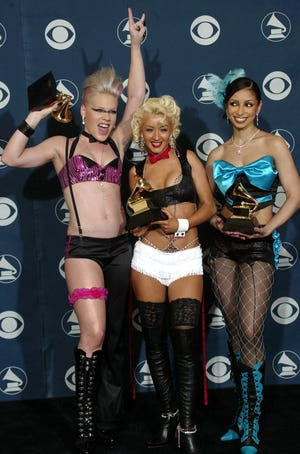 """Pink, left, Christina Aguilera and Mya with their Grammy for best pop collaboration with vocals for """"Lady Marmalade."""""""