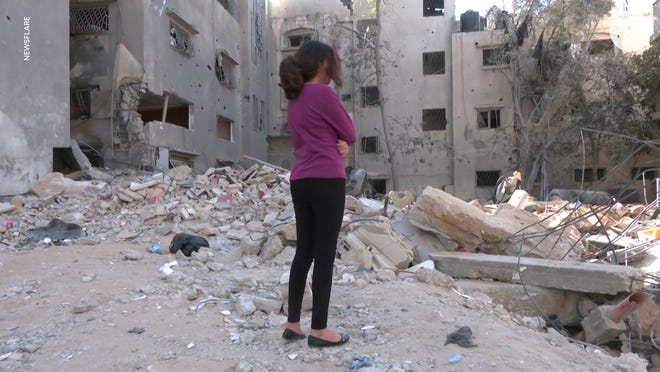 Nadine Abdel-Taif is a 10-year-old girl living in Gaza who sleeps on a mattress in the hallway when her family hears missiles flying at night.
