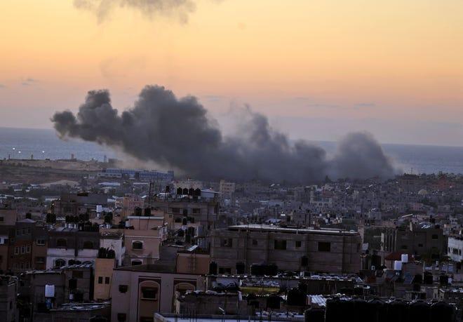 Smoke billows following an Israeli airstrike in Rafah in the southern Gaza Strip on May 18, 2021.