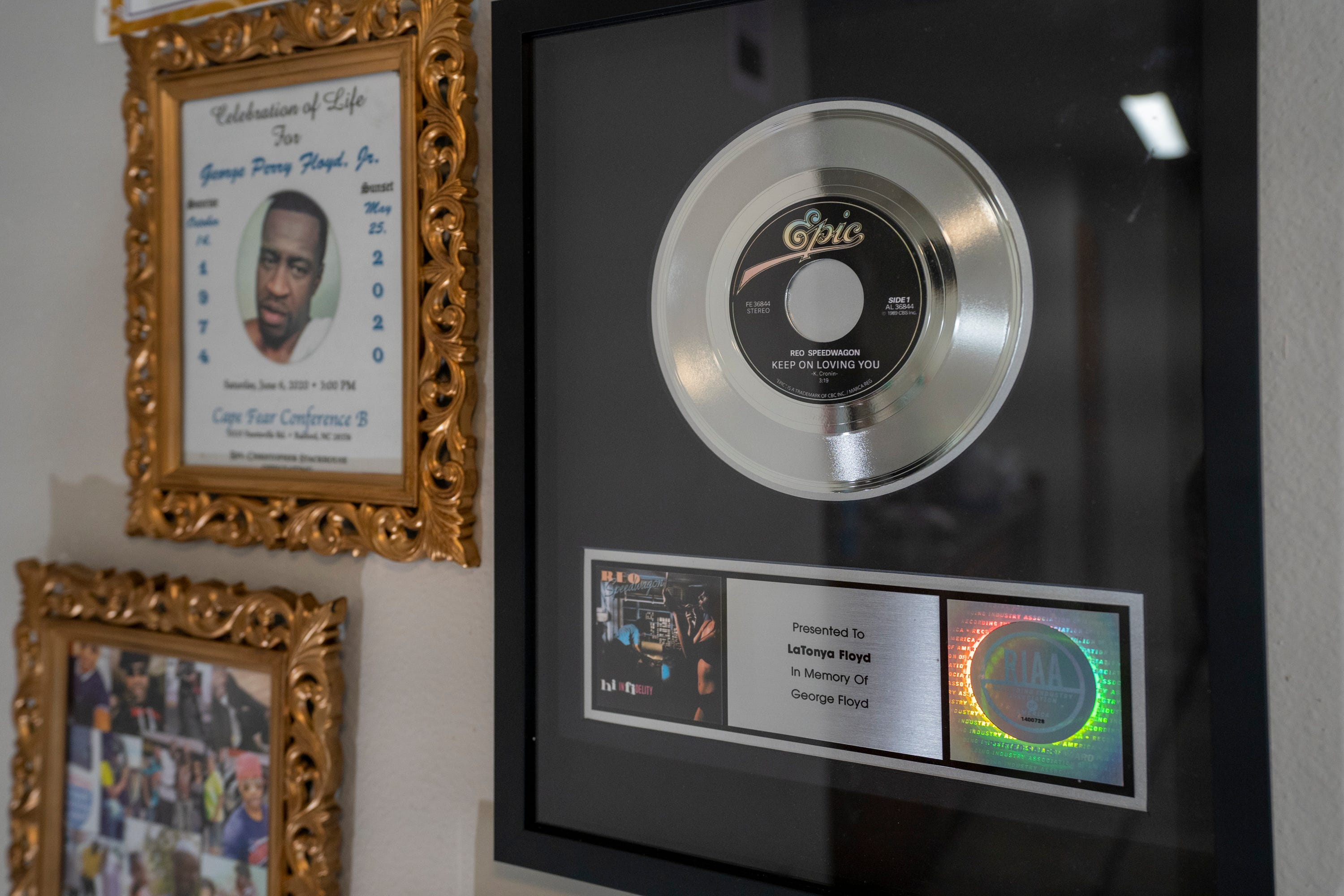 """A platinum record for the REO Speedwagon song """"Keep on Loving You,"""" a gift to LaTonya Floyd from lead singer Kevin Cronin in memory of her brother George Floyd, hangs on the wall in Floyd's niece's home"""