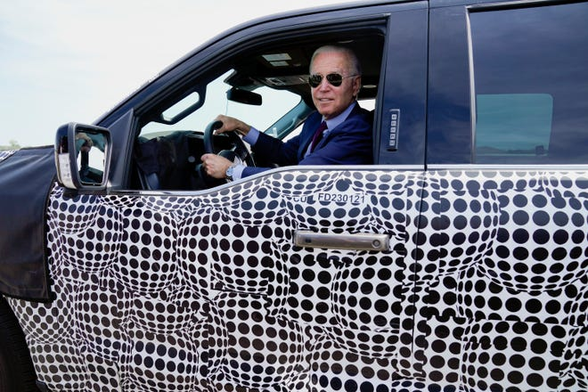President Joe Biden stops to talk to the media as he drives a Ford F-150 Lightning truck at Ford Dearborn Development Center on Tuesday in Dearborn, Mich.