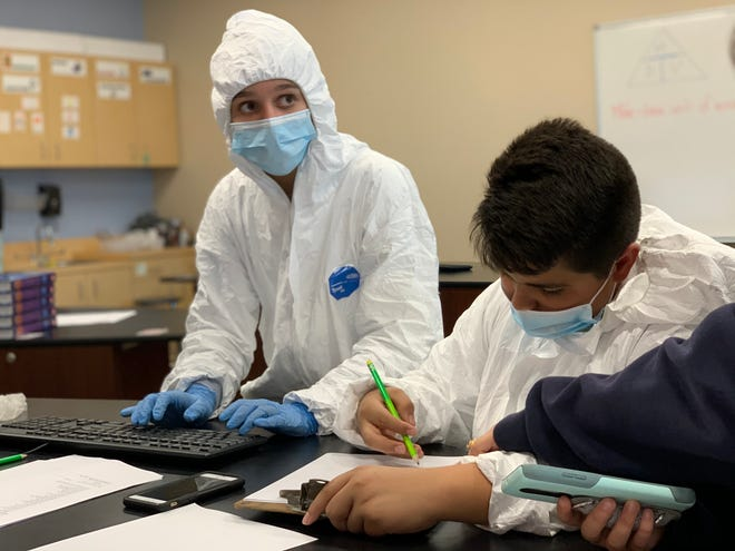 """Overwhelmed student """"doctors"""" in the December 2019 version of the Operation Outbreak simulation at the Sarasota Military Academy Prep enter symptoms as they  try to keep up with the high demand of treating patients."""