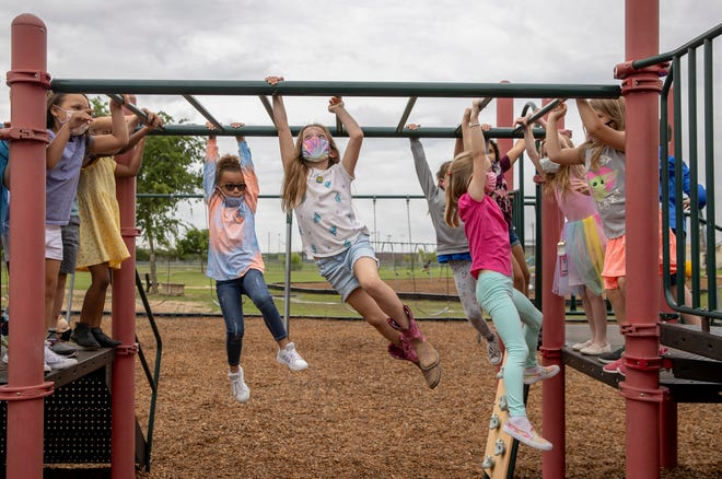 First-graders play during recess at Carpenter Hill Elementary School in Buda in May. The monkey bars cause a lot of broken bones.
