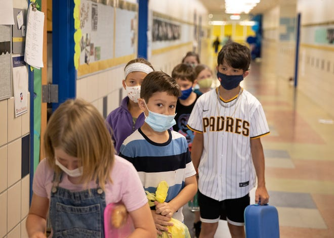 Fourth-graders line up for lunch at an elementary school in Buda, Texas, on Wednesday.