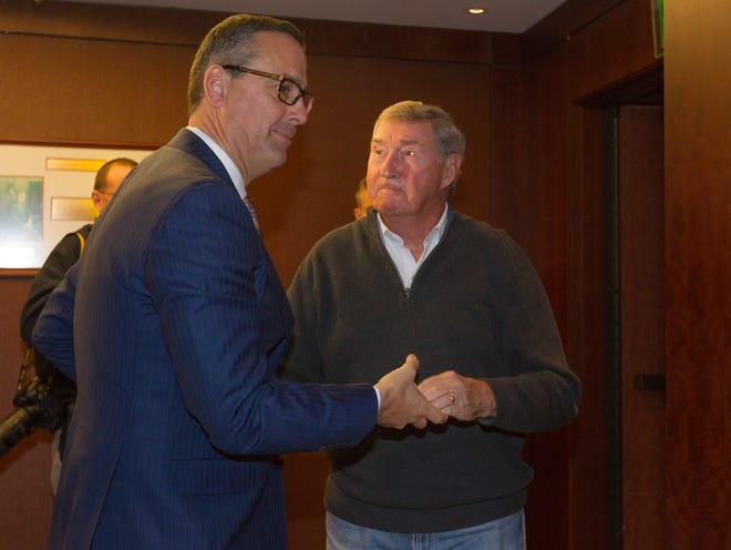 Texas athletic director Chris Del Conte, left, speaks with former Texas athletic director DeLoss Dodds during Del Conte's introductory press conference in Dec. 2017. Dodds, who retired in 2014 after 32 years, thinks Texas and Texas A&M will play each other in football again.