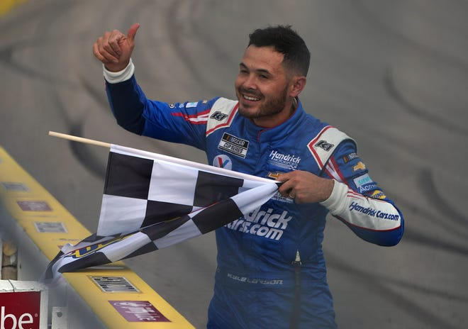NASCAR Cup Series driver Kyle Larson celebrates his victory in the Pennzoil 400 at Las Vegas Motor Speedway in March. Larson was suspended by NASCAR last season for his use of a racial slur while he competed in a virtual iRacing competition.