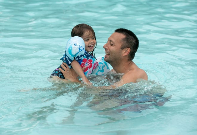 Michael Reyes and his daughter Rosie, 3, take a dip at Rosewood Pool in June 2020. Before you head to a pool or other body of water this summer, get educated and form a safety plan.