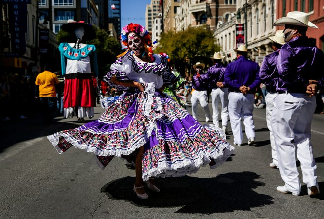 A woman dances during the Mexic-Arte Museum's 36th Annual Viva La Vida Festival and Parade in downtown Austin in 2019. The City Council should invest in keeping the city's arts and culture scene alive, Sharon Maidenberg writes.  [BRONTE WITTPENN/AMERICAN-STATESMAN]