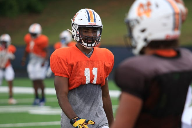 UGA commit De'Nylon Morrissette walks back to the huddle during North Cobb spring practice with new quarterback and 2023 UGA target Malachi Singleton in the foreground.