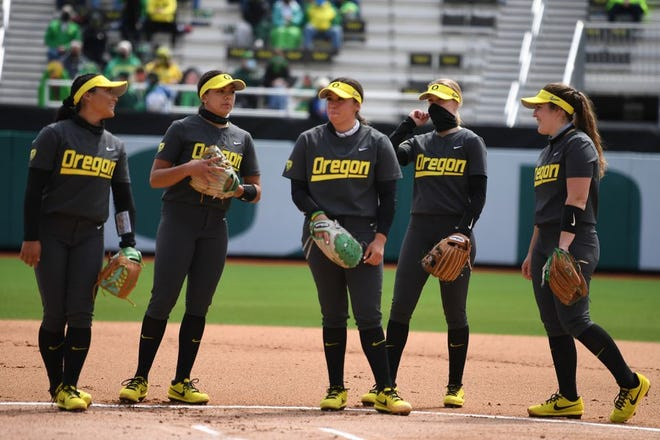 Oregon players wait to take the field before their April 10 game against UCLA. At the time, the Ducks were ranked No. 3 in the country and the Bruins were No. 2. UCLA won 3-0.
