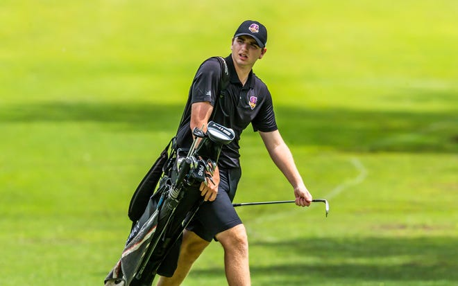 Hickman's David Polacek walks during the final round of the Class 5 boys state golf championship Tuesday at Sedalia Country Club in Sedalia.