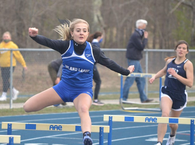 Inland Lakes' Christy Shank competes in the 300-meter hurdle event during the Inland Lakes Invitational earlier this season. Shank has made the most of her senior season, earning several first places and helping the Bulldogs to two invitational title wins this spring.