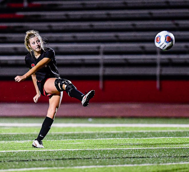 In the 12th minute of sudden-victory overtime, the ball rises off the foot of Chillicothe High School soccer Lady Hornets senior Allison Ishmael on its way to entering the Savannah goal about 25 yards away to win Tuesday night's Class 2 District 8 Tournament match in Chillicothe 1-0.
