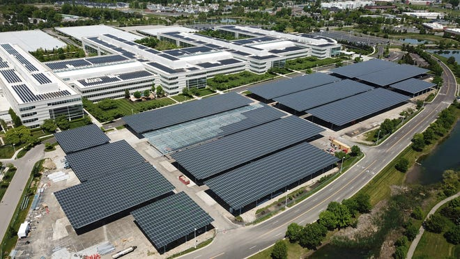 JP Morgan Chase covers its massive parking lot with solar energy panels while also creating covered parking for workers.
