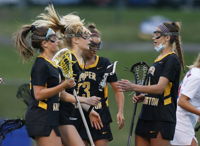 Upper Arlington's Camryn Callaghan (4), Rian Adkins (5), Annie Hargraves (3) and Clara Gallapoo (1) celebrate Adkins' goal against Thomas Worthington on March 25. The teams have a rematch Tuesday in the playoffs.