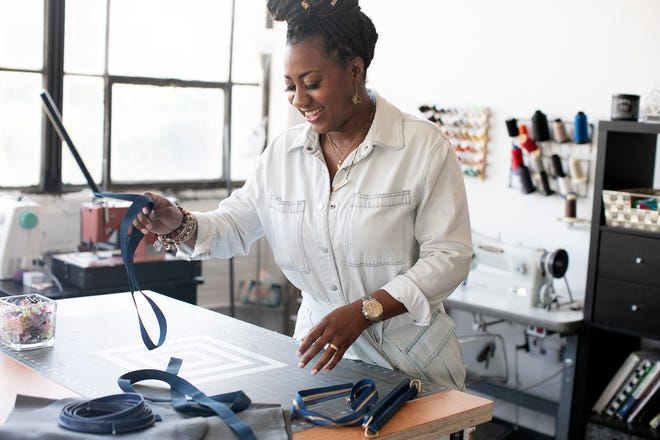 Jovanna Robinson works in her studio at 400 West Rich, where she makes and sells her own travel bags, totes and men's and women's handbags under her brand Tonē Bekka, Wednesday, May 19, 2021.