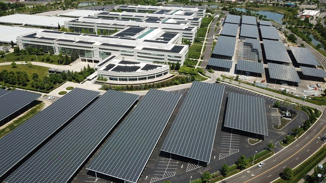 JPMorgan Chase's work to cover a huge parking lot with solar panels and create a covered parking lot for workers is almost complete.