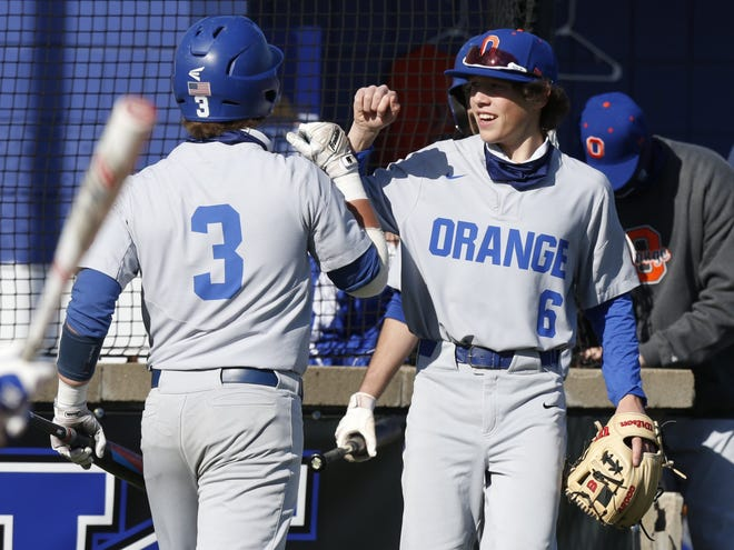 Olentangy Orange's Charlie Scholvin (6) congratulates teammate Logan Shearer after Shearer scored against Worthington Kilbourne on April 2. Orange is 23-3 and has been the No. 1 ranked team in Ohio in Division I for four of the five weeks of the season.