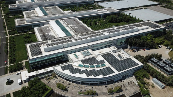 The JPMorgan Chase McCoy Center has been installing solar panels on the roof for several years. They are currently covering huge parking lots with solar panels while creating covered parking lots for workers.