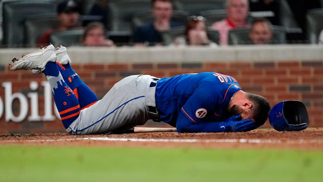"""The Mets' Kevin Pillar lies on the ground after being hit in the face with a pitch from Braves reliever Jacob Webb on Monday. Pillar said he had no hard feelings toward Webb. """"I know this guy didn't want to hit me in the face,"""" he said. """"I'm almost more worried about him than myself."""""""