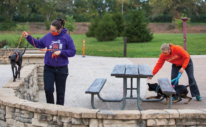 Adventure Unleashed co-founders Karin Coyne, right, and Abigail Curtis, left, work with their dogs, Carl and Mouse, at Scioto Audobon Metro Park.
