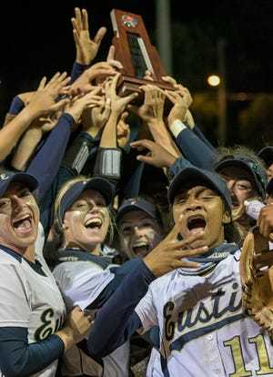The Eustis Panthers celebrate while holding the trophy after winning the Class 4A-Region 2 championship Friday against Belleview. The Panthers face Orange Park Ridgeview Thursday in the Class 4A state semifinals in Clermont. [PAUL RYAN / CORRESPONDENT]