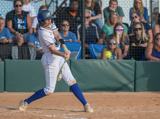 Mount Dora Christian Academy first baseman Tootie Todd (5) doubles in two runners during Tuesday's Class 2A state semifinal game against Jacksonville University Christian at Legends Way Ballfields in Clermont. [PAUL RYAN / CORRESPONDENT]