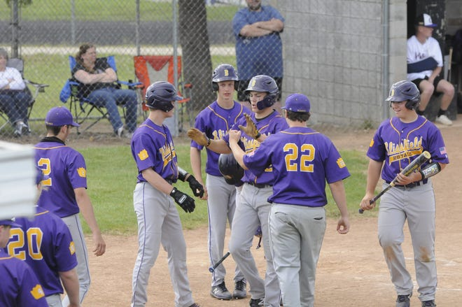 Blissfield's Gavin Ganun, center with hands raised, is congratulated by teammates after hitting a grand slam home run in the fourth inning of game one of the Royals' LCAA doubleheader at Onsted on Tuesday.