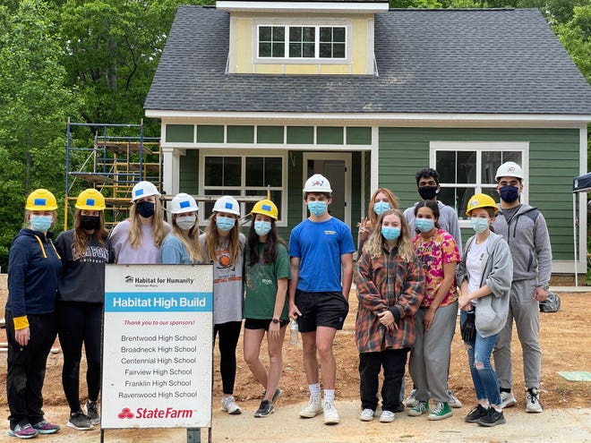 Students from Centennial and Ravenwood High Schools participate in the latest Habitat for Humanity Williamson-Maury build, which included several student volunteers from multiple regional schools.