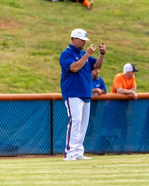 Randleman head coach Jake Smith delivers signs to a player on second base during their win over Wheatmore 12-0 in 5 innings in their home opener on April 29, 2021. [PJ WARD-BROWN PHOTOGRAPHY]