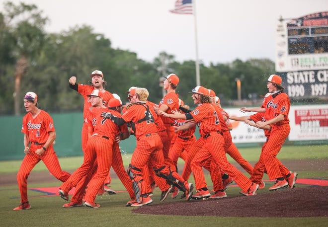 Spruce Creek celebrates after a 5-1 regional final victory at Lake Brantley. Brandon Neely pitched a complete game and cracked a two-run triple.
