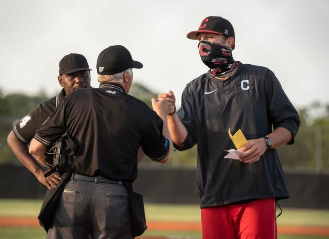 Chris Hopkins, right, guided New Smyrna Beach to the second round of the FHSAA Class 6A playoffs this year. On Tuesday, he was hired as head coach of his alma mater, DeLand.