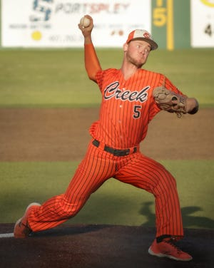 In addition to his dominant pitching performance, Brandon Neely (5) tripled in two runs for the Hawks on Saturday.