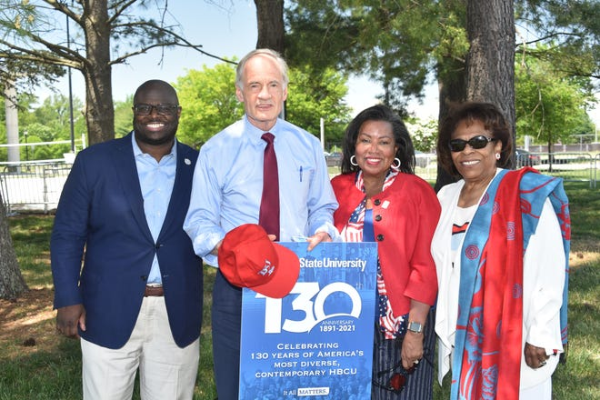 DSU President Tony Allen, Sen. Tom Carper, DSU Board Chair Devona Williams and past DSU President Wilma Mishoe pose for a photo during Delaware State University's 130th anniversary celebration.