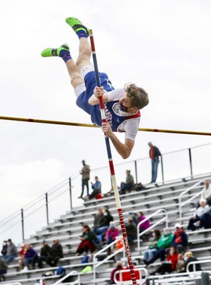 Carbondale Area's Bayley Grizzanti sails through the air and into the school record book. The senior pole vaulter cleared the bar at a height of 12 feet and one quarter inch, setting a brand new standard for the Chargers.