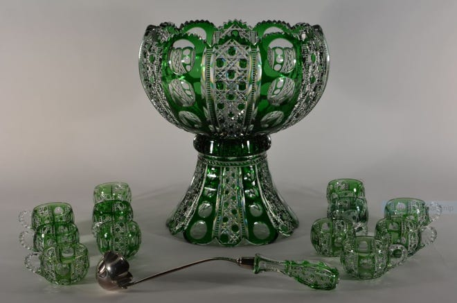 Green cut to clear punch bowl set in Dorflinger's Montrose pattern.  C. Dorflinger & Sons, White Mills, Pennsylvania, about 1895.  This punch bowl set is part of the Dorflinger Factory Museum's special exhibit entitled Bowls of Holiday Cheer: Eighteen Dorflinger Punch Bowls.